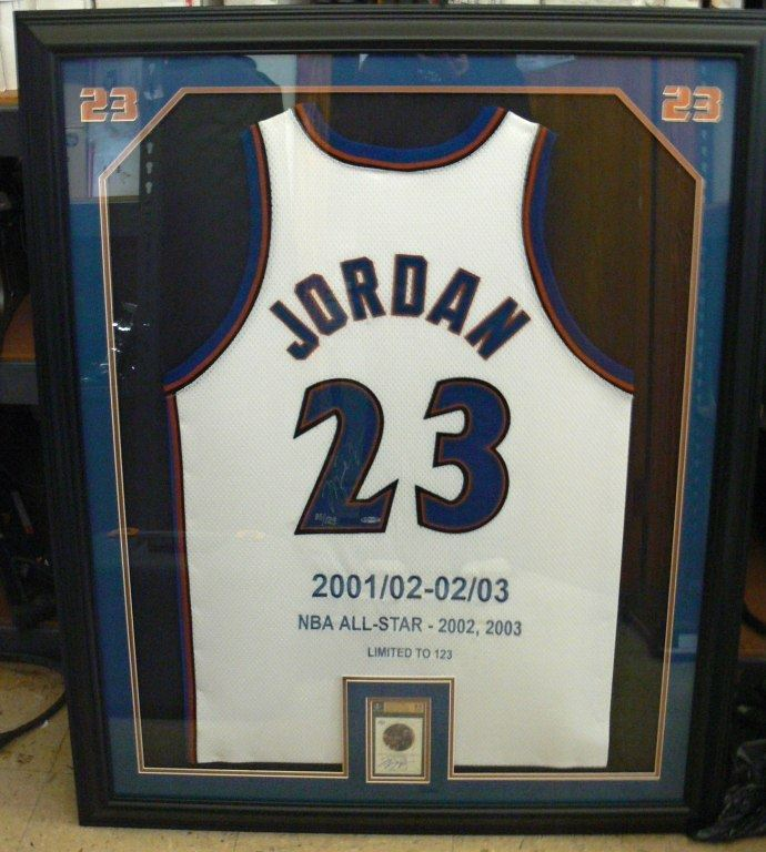 Cash USA Pawnshop. FRAMED MICHAEL JORDAN SIGNED JERSEY AND CARD