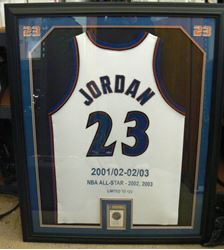 Picture of FRAMED MICHAEL JORDAN SIGNED JERSEY AND CARD