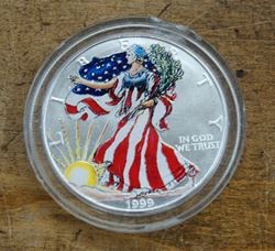 Picture of 1999 1 oz. fine silver...one dollar painted silver eagle  mint