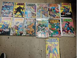 Picture of LOT 13 CAPTAIN AMERICA MARVEL COMICS 317  MAY; 324 DECEMBER;  310 OCTOBER; 312 DECEMBER;  316 APRIL; 328 APRIL;  325 JANUARY;  313 JANUARY;  292 APRIL;  331 JULY;  306 JUNE; 309 SEPTEMBER. GOOD CONDITION. COLLECTIBLE.