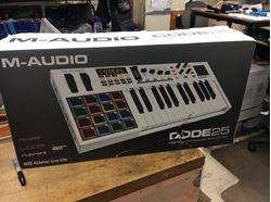 Picture of M-audio mixing board midi control code 25 new . In box .