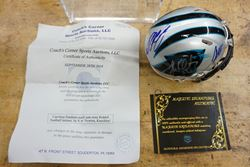 Picture of CAROLINA PANTHERS MULTI AUTO MINI HELMET BY 4 NEWTON KUECHLEY RIDDELL WITH COA; PLASTIC CASE. MINT CONDITION. COLLECTIBLE