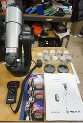 Picture of MEADE ETX 60 BACKPACK OBSERVATORY TELESCOPE WITH EXTRAS . NO TRIPOD. USED. TESTED. IN A GOOD WORKING ORDER. MINT CONDITION. WITH EXTRAS -MANUAL; BACKPACK; REMOTE; 3 DVDS; 5 LENSES MEADE MA 12MM; MEADE MA 4MM; MEADE MA 4MM; MEADE MA 25MM; MEADE MA 12MM. PLEASE LOOK AT ALL THE PICTURES .