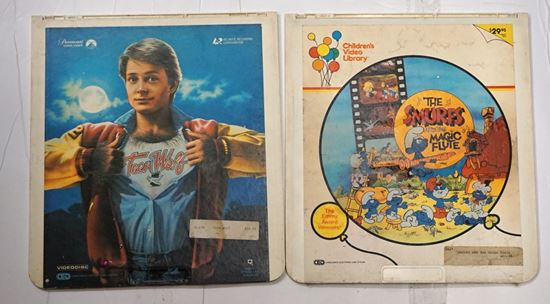 Picture of LOT 2  VIDEO DISCS THE SMURFS AND MAGIC FLUTE 1984 APPROXIMATELY 74 MIN; TEEN WOLFE 1985 92 MIN COLOR. COLLECTIBLE .