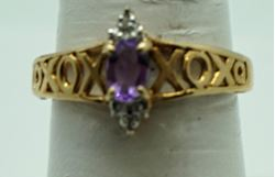 Picture of 10kt yellow gold ring with oval amethyst and 2 small round diamonds . Size 7 . Pre owned. very good. Total weight 2.2  . 824461-4.