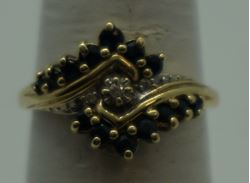 Picture of 10kt yellow gold ring size 7 w 3 diamonds 0.03pts & 14 bround blue stones 2.3 gr. pre owned. very good condition. 849494-1.