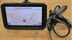 Picture of garmin dezl 770 Truck GPS Navigator with 7-inch Display gently used. tested. in a good working order.