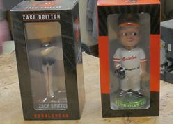 Picture of lot of 2 orioles booble head figurines Zach Britton; Vintage Girl #1 Orioles fan. very condition collectible.