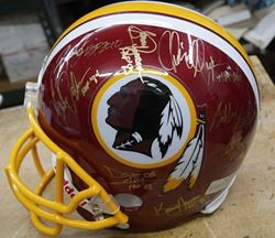 Picture of WASHINGTON REDSKINS SIGNED TEAM REPLICA NFL HELMET WITH COA COLLECTIBLE.  VERY GOOD CONDITION.