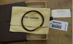 Picture of Louis Vuitton cowhide leather bracelet M6609D pre owned with case and dust bag.  pre owned. very good condition.